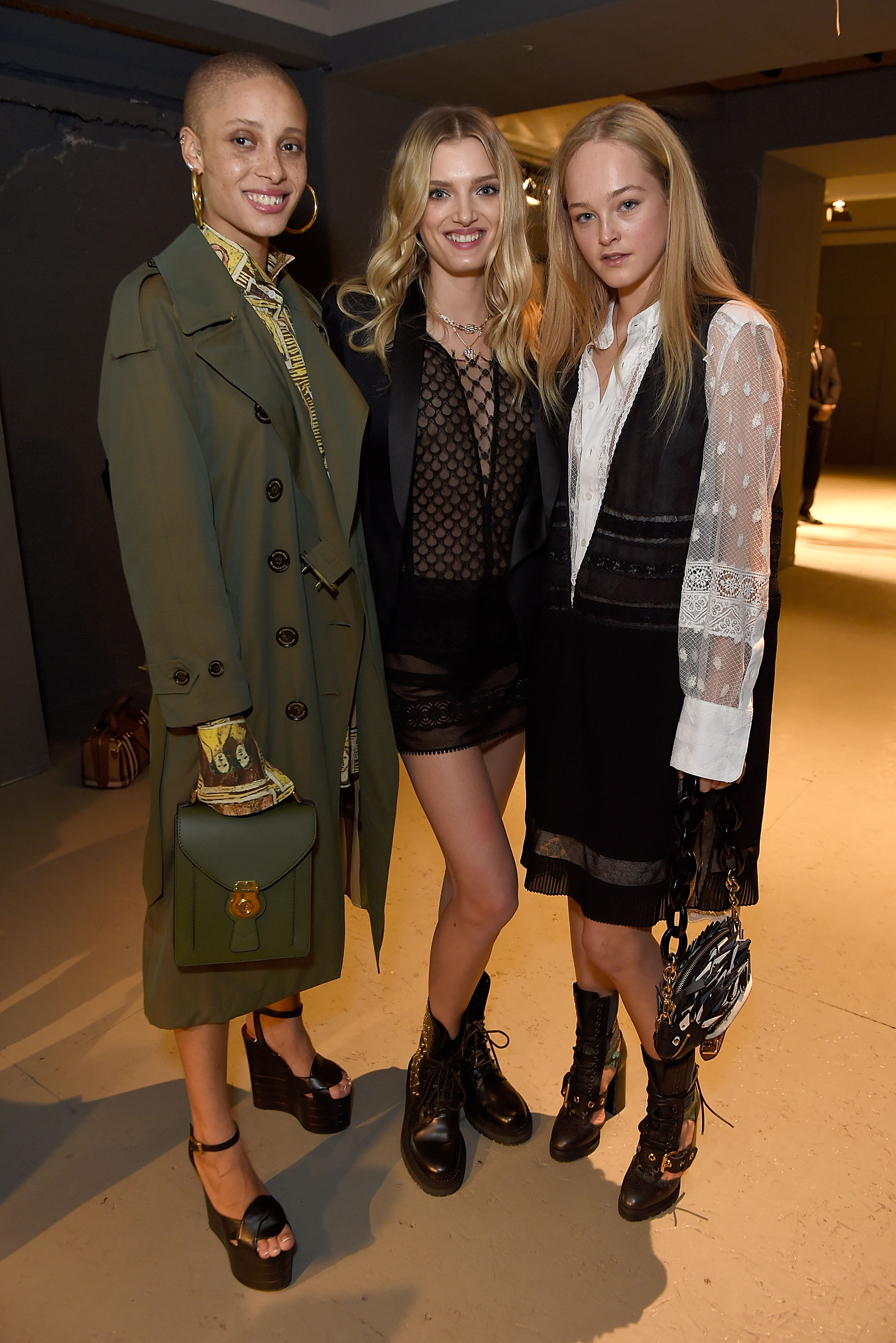 LONDON, ENGLAND - FEBRUARY 20:  (L-R) Adwoa Aboah, Lily Donaldson and Jean Campbell wearing Burberry attend the Burberry February 2017 Show during London Fashion Week February 2017 at Makers House on February 20, 2017 in London, England.  (Photo by David M. Benett/Dave Benett/Getty Images for Burberry) *** Local Caption *** Adwoa Aboah; Lily Donaldson; Jean Campbell