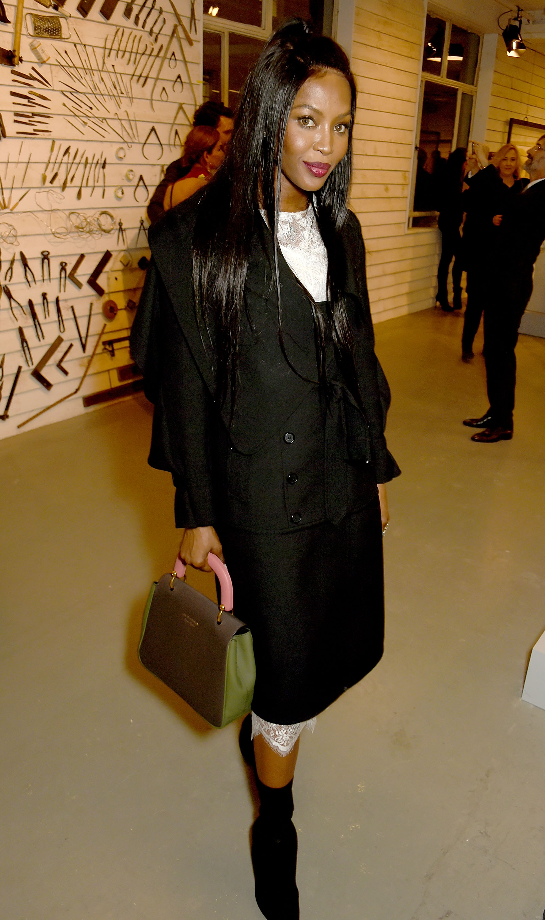 LONDON, ENGLAND - FEBRUARY 20:  Naomi Campbell wearing Burberry attend the Burberry February 2017 Show during London Fashion Week February 2017 at Makers House on February 20, 2017 in London, England.  (Photo by David M. Benett/Dave Benett/Getty Images for Burberry) *** Local Caption *** Naomi Campbell
