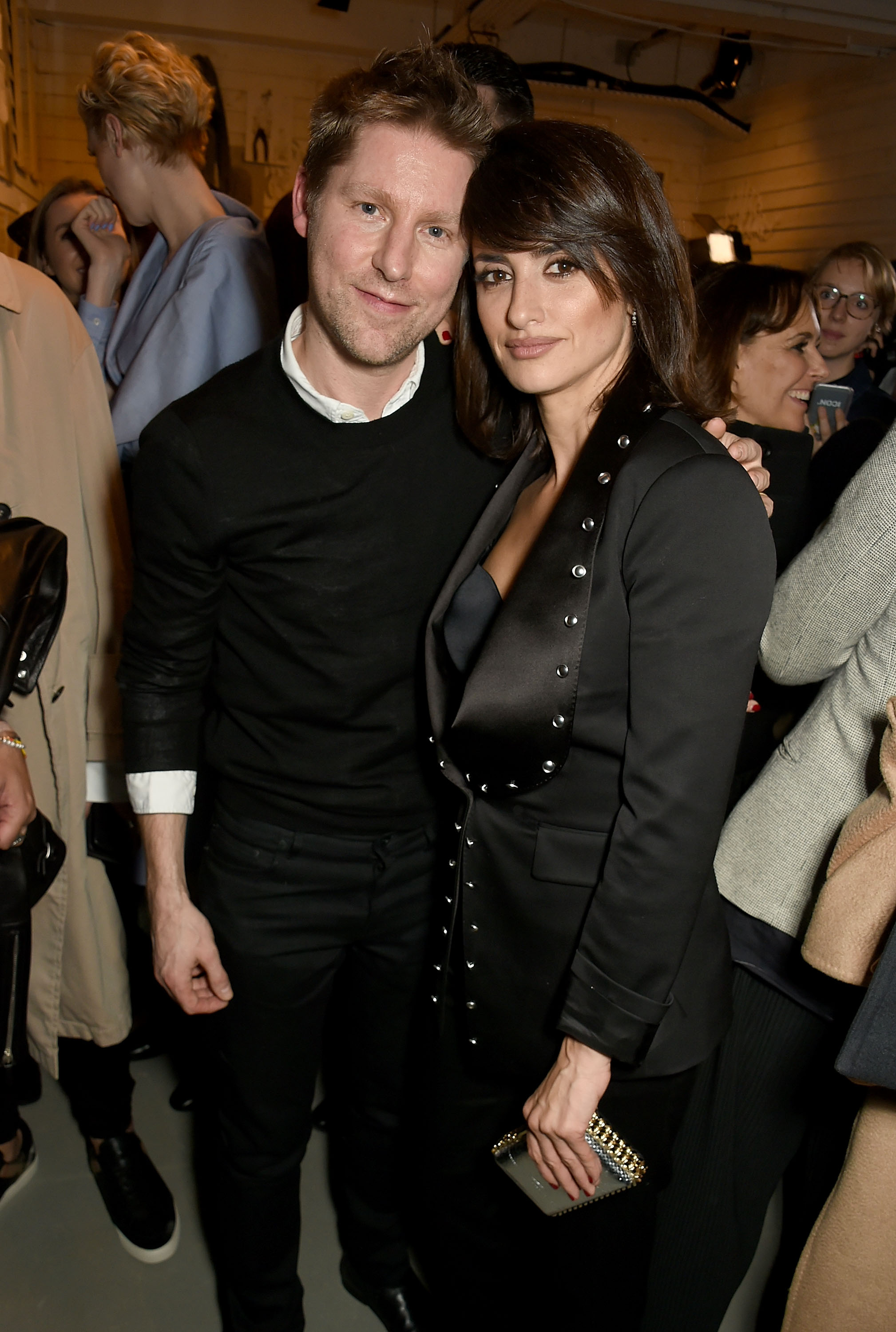 LONDON, ENGLAND - FEBRUARY 20:  Penelope Cruzl and Burberry CEO Christopher Bailey attend the Burberry February 2017 Show during London Fashion Week February 2017 at Makers House on February 20, 2017 in London, England.  (Photo by David M. Benett/Dave Benett/Getty Images for Burberry) *** Local Caption *** Penelope Cruz; Christopher Bailey