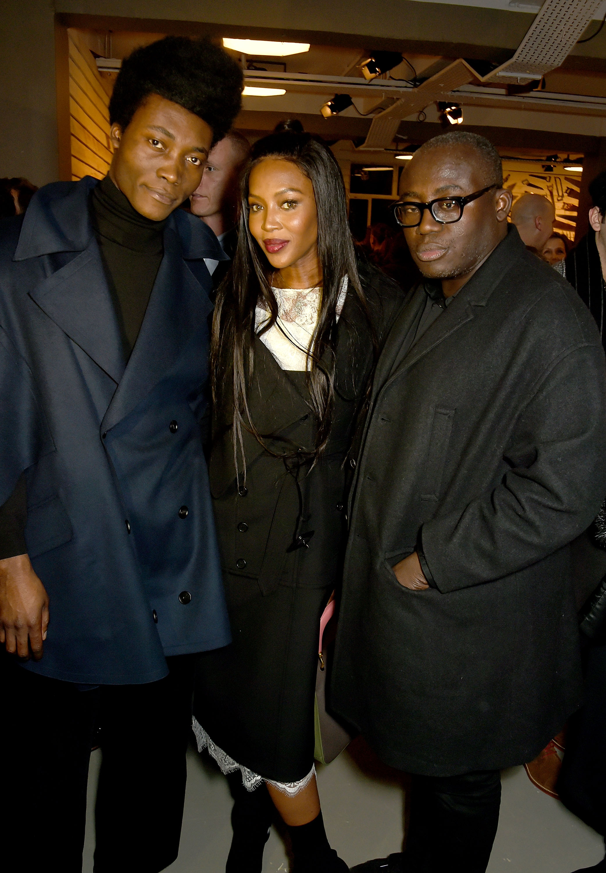 LONDON, ENGLAND - FEBRUARY 20:  (L-R) Benjamin Clementine, Naomi Campbell and Edward Enninful attend the Burberry February 2017 Show during London Fashion Week February 2017 at Makers House on February 20, 2017 in London, England.  (Photo by David M. Benett/Dave Benett/Getty Images for Burberry) *** Local Caption *** Benjamin Clementine; Naomi Campbell; Edward Enninful
