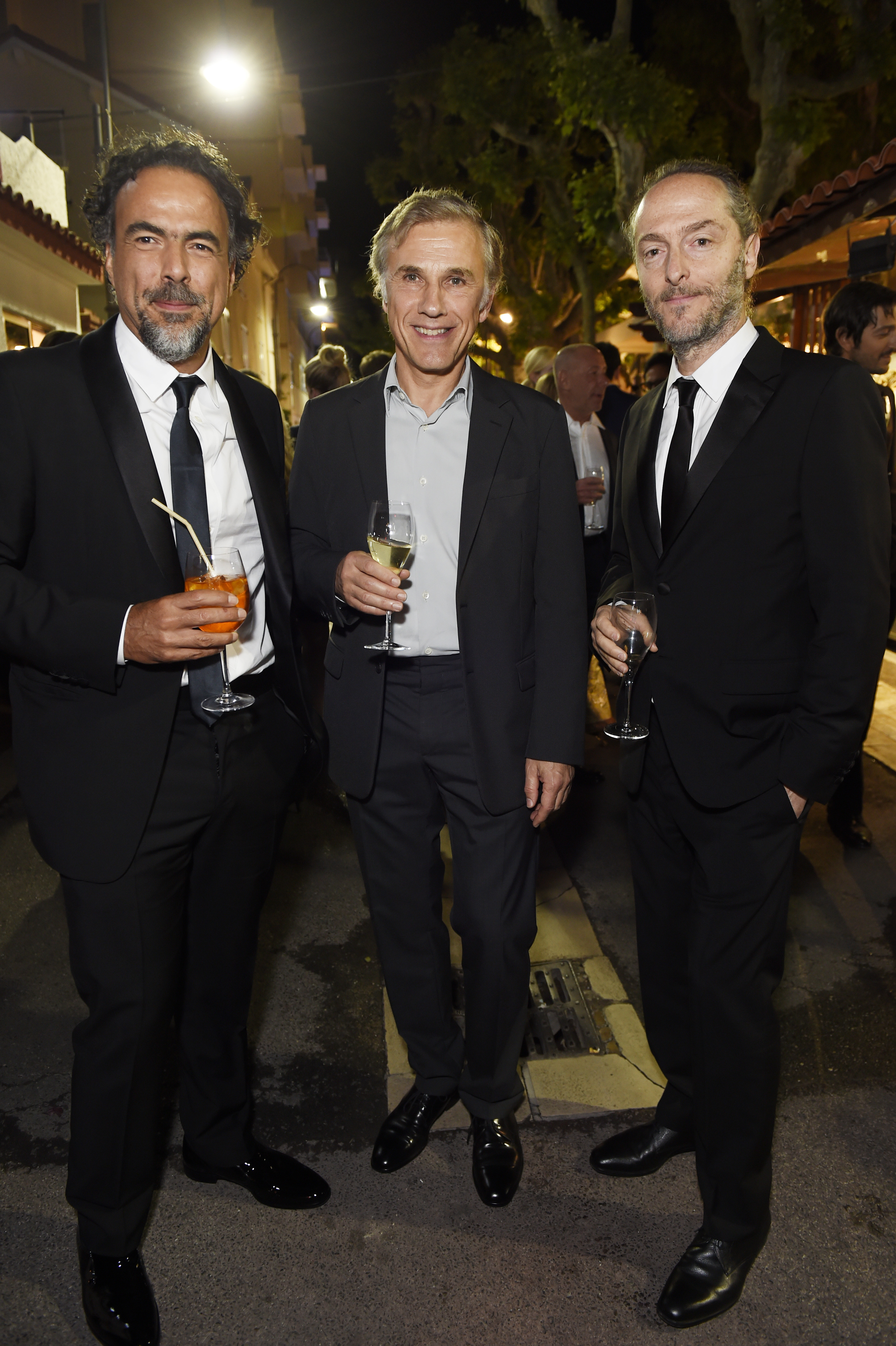 CANNES, FRANCE - MAY 22:  Alejandro Gonzalez Inarritu, Christoph Waltz and Emmanuel Lubezki attend Prada Private Dinner during the 70th annual Cannes Film Festival at Restaurant Fred L'Ecailler on May 22, 2017 in Cannes, France.  (Photo by Antony Jones/Getty Images for Prada)