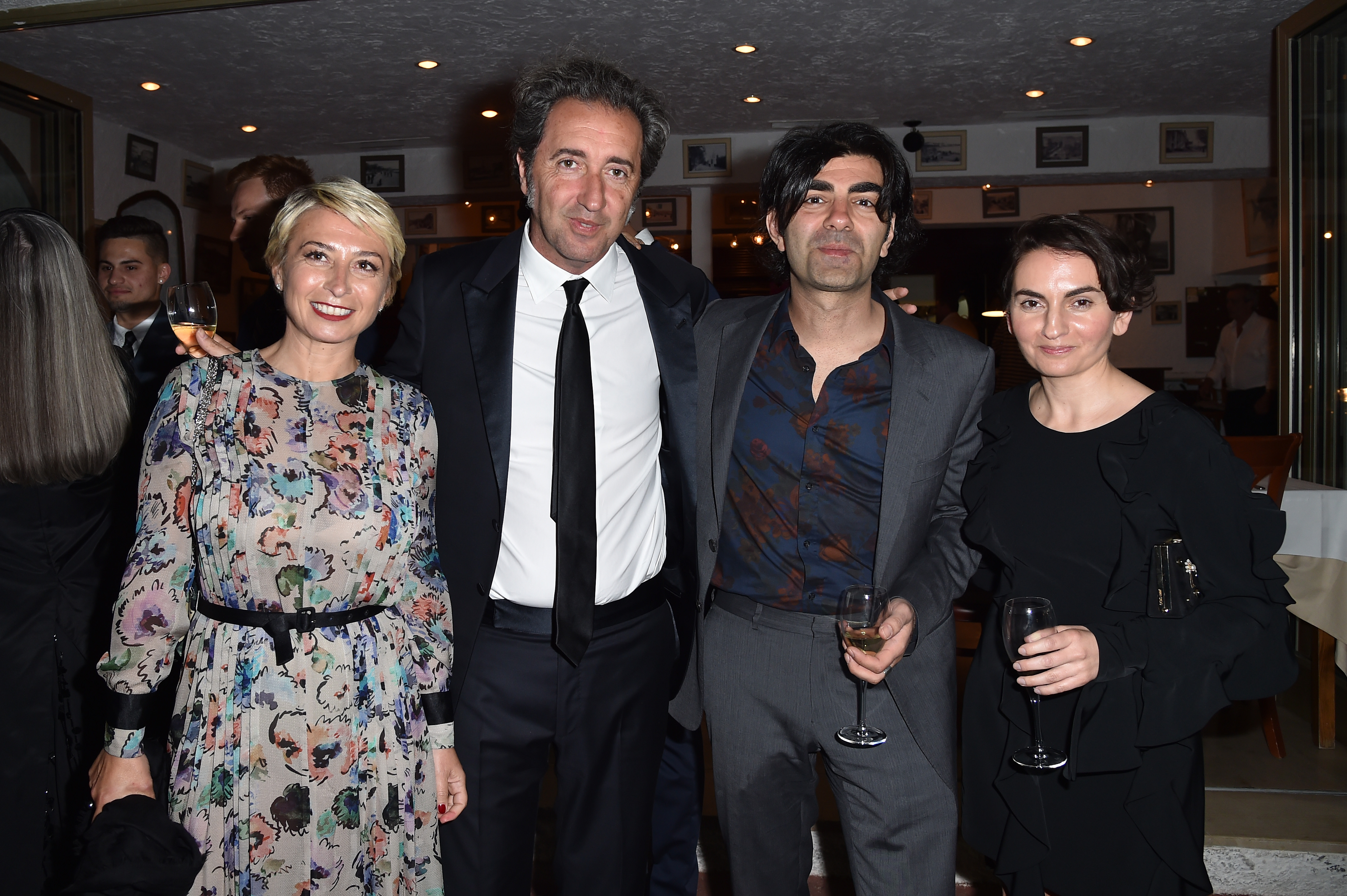 CANNES, FRANCE - MAY 22:  Daniela D'Antonio, Paolo Sorrentino, Faith Aktin and Christina Bazdekis  attend Prada Private Dinner during the 70th annual Cannes Film Festival at Restaurant Fred L'Ecailler on May 22, 2017 in Cannes, France.  (Photo by Jacopo Raule/Getty Images for Prada)