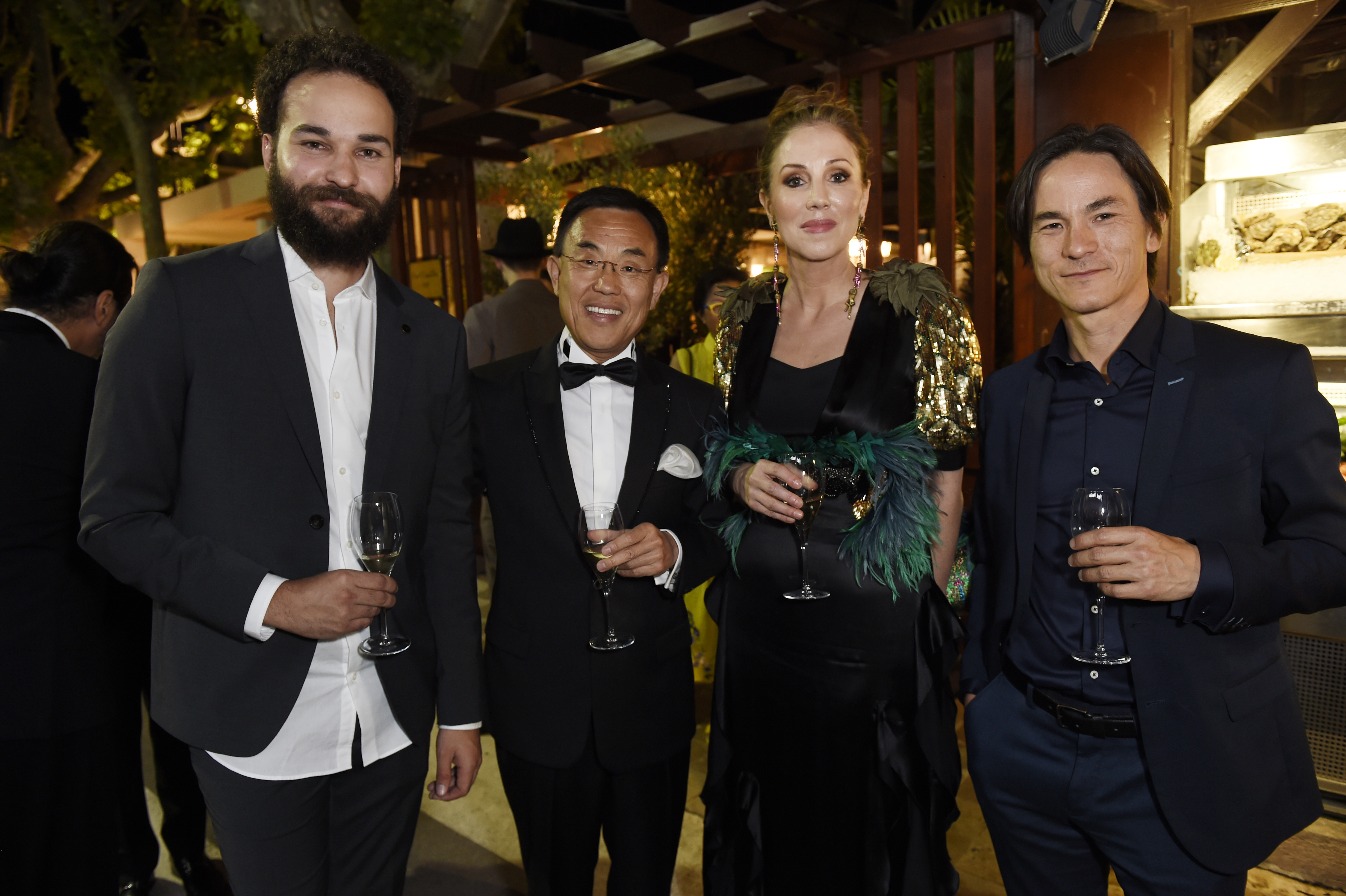 CANNES, FRANCE - MAY 22:  Max Devolder, Jack Gao, Mary Parent and Benoit Chang attends Prada Private Dinner during the 70th annual Cannes Film Festival at Restaurant Fred L'Ecailler on May 22, 2017 in Cannes, France.  (Photo by Antony Jones/Getty Images for Prada)