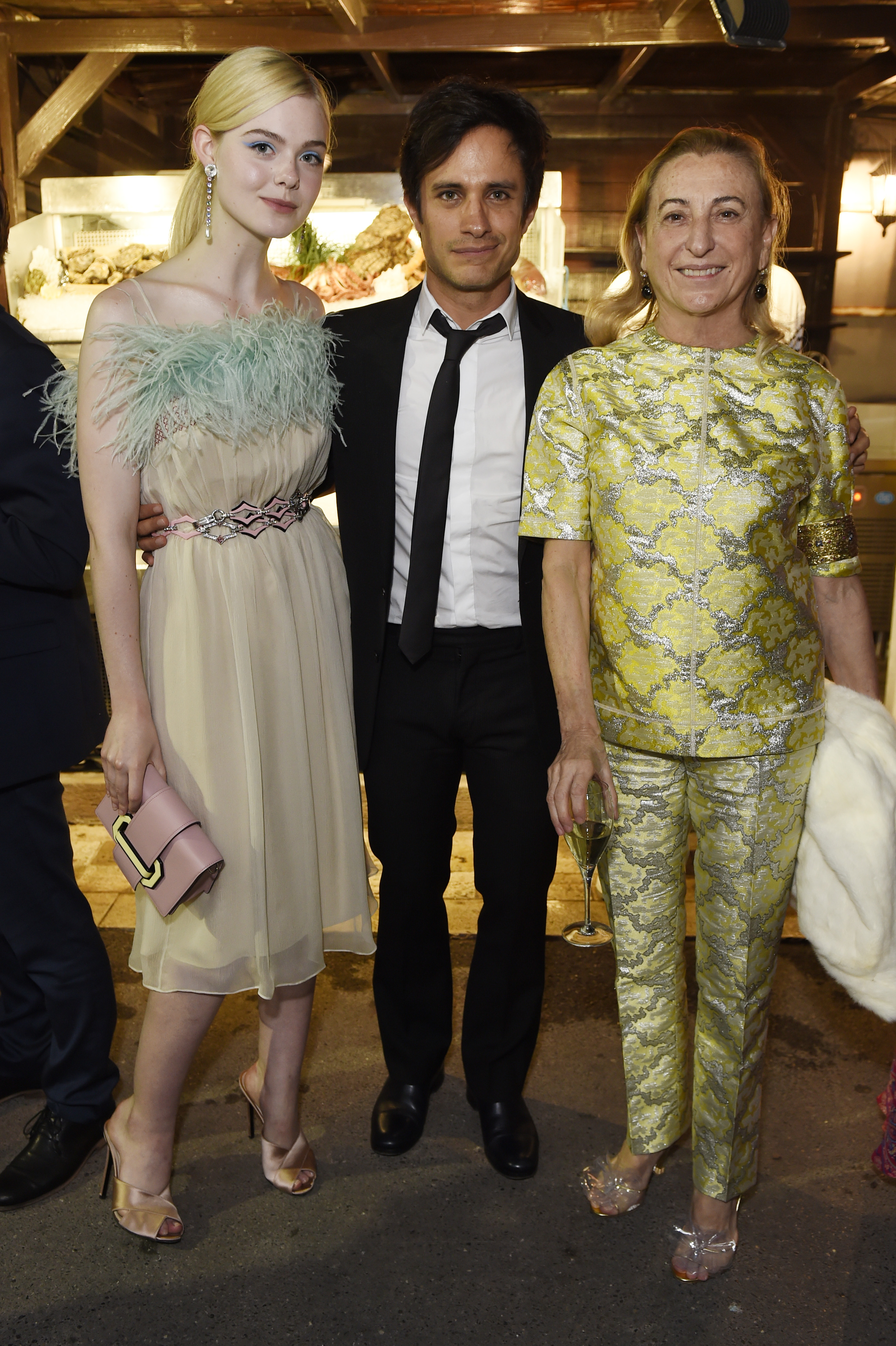 CANNES, FRANCE - MAY 22:  Elle Fanning, Gael Garcia Bernal and Miuccia Prada attend Prada Private Dinner during the 70th annual Cannes Film Festival at Restaurant Fred L'Ecailler on May 22, 2017 in Cannes, France.  (Photo by Antony Jones/Getty Images for Prada)