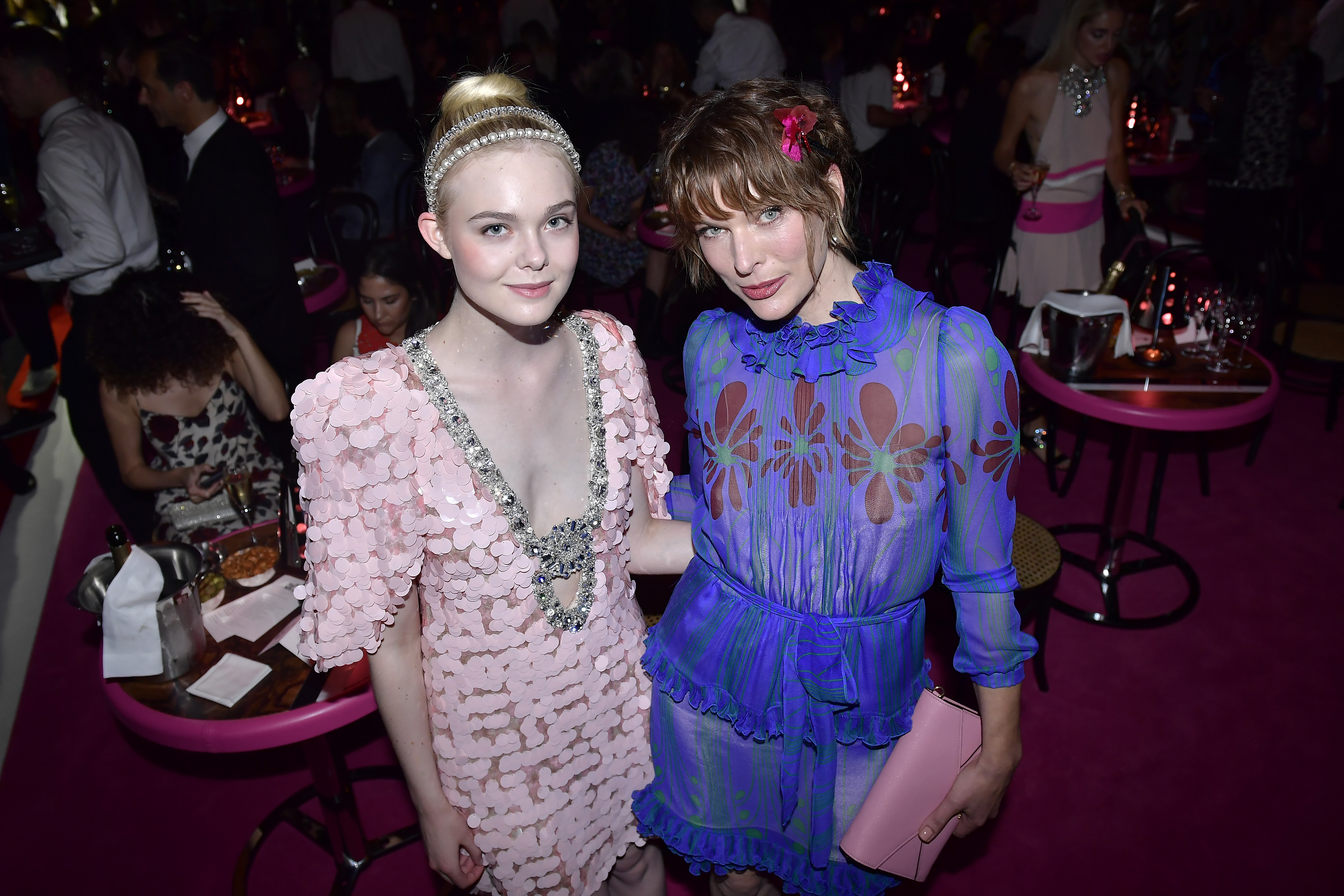 PARIS, FRANCE - JULY 02:  Elle Fanning and  Milla Jovovich attend Miu Miu Cruise Collection show as part of Haute Couture Paris Fashion Week on July 2, 2017 in Paris, France.  (Photo by Victor Boyko/Getty Images for Miu Miu) *** Local Caption *** Elle Fanning, Milla Jovovich