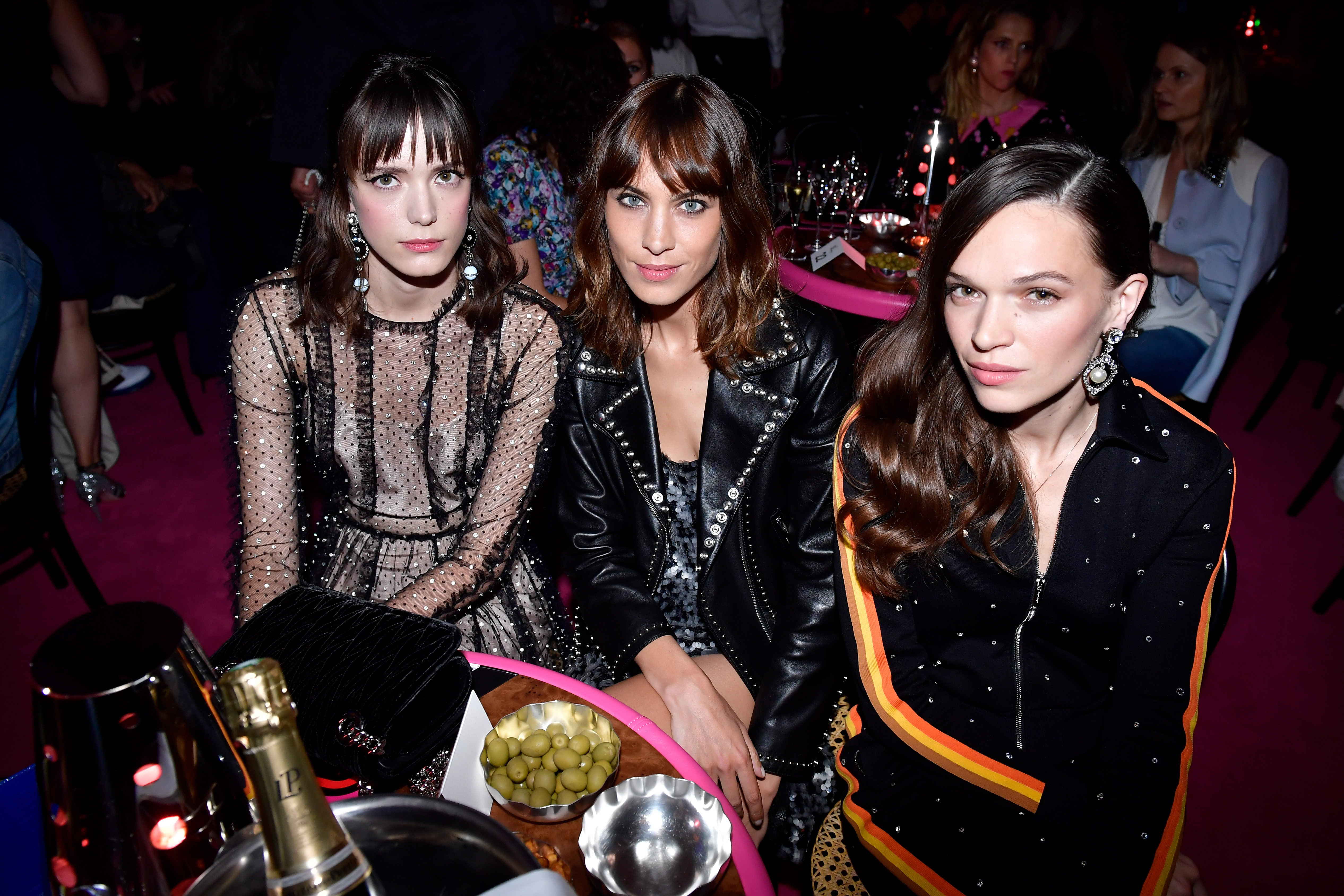 PARIS, FRANCE - JULY 02:  Stacy Martin, Alexa Chung and Anna Brewster attends Miu Miu Cruise Collection show as part of Haute Couture Paris Fashion Week on July 2, 2017 in Paris, France.  (Photo by Victor Boyko/Getty Images for Miu Miu)