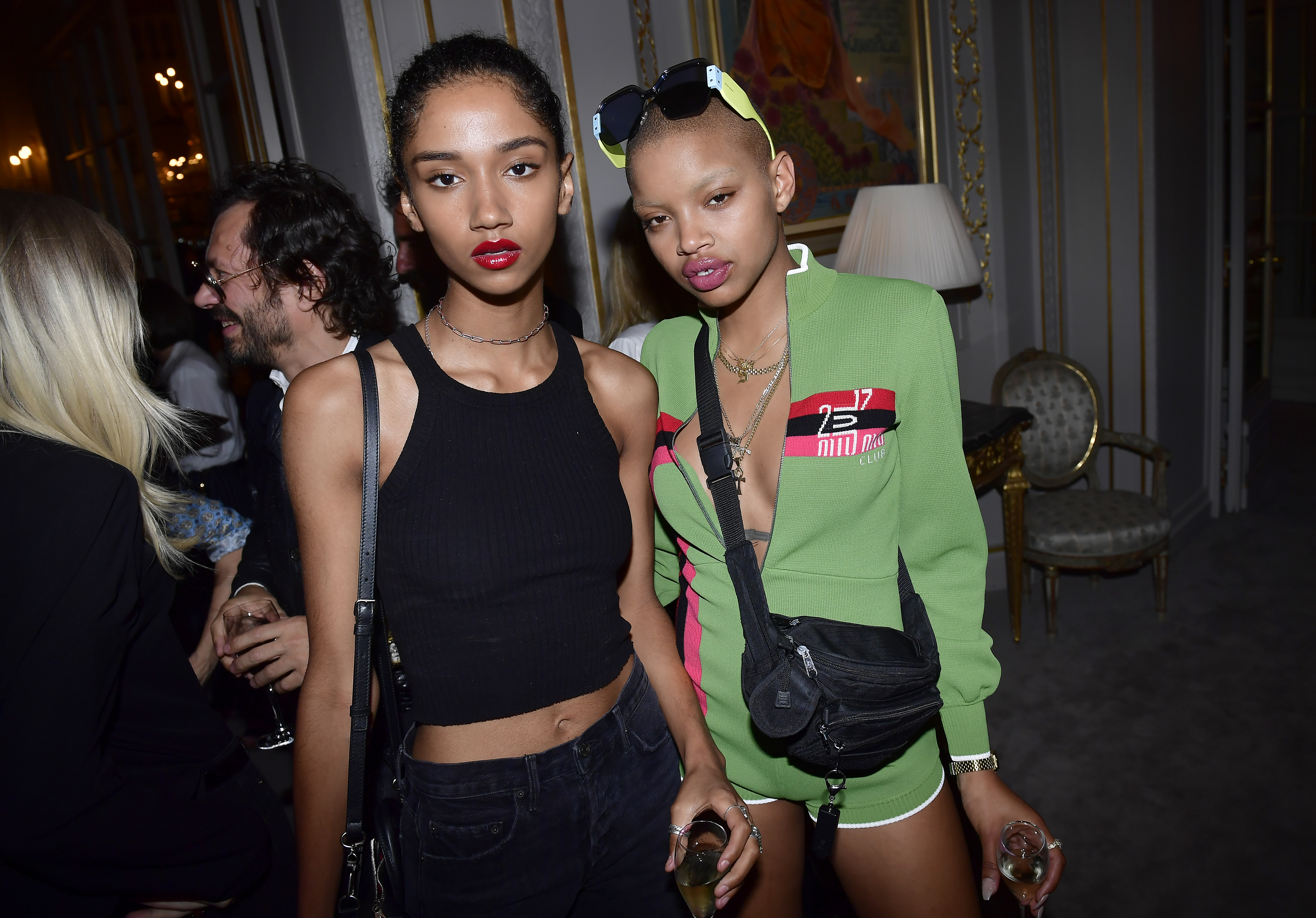 PARIS, FRANCE - JULY 02: Slick Woods (R) and a guest attend Miu Miu Cruise Collection cocktail & party as part of Haute Couture Paris Fashion Week on July 2, 2017 in Paris, France.  (Photo by Victor Boyko/Getty Images for Miu Miu) *** Local Caption *** Slick Woods